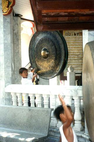 Kids beating the gongs